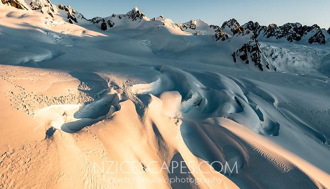 Large crevasses of upper parts of Franz Josef Glacier at sunset, Westland Tai Poutini National Park, West Coast, UNESCO World Heritage Area, New Zealand, NZ