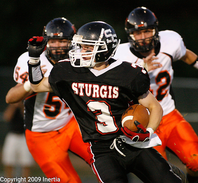 STURGIS, SD - SEPTEMBER 18, 2009 --   Seth Lange #3 of Sturgis surges around Sioux Falls Washington defenders during their game Friday evening at Woodle Field. (Photo by Dick Carlson/Inertia)