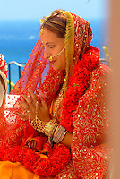 Tradditional Hindi wedding with bride with indian adornments in prayer