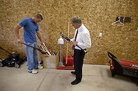 Brandon Nimmo, left, and his father, Ron Nimmo, pick out bats in the family barn batting cage on Tuesday, June 21, 2011, in Cheyenne, Wyo. (Photo by James Brosher)
