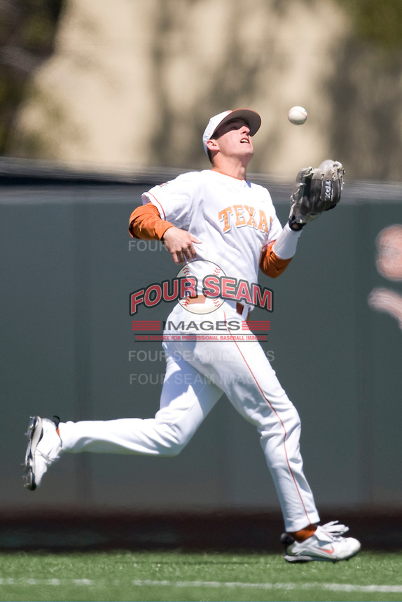 Texas Longhorn shortstop Brandon Loy makes a over the shoulder catch against Nebraska on Sunday March 21st, 2100 at UFCU Dish-Falk Field in Austin, Texas.  (Photo by Andrew Woolley / Four Seam Images)