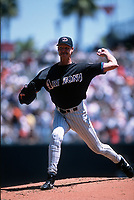 SAN FRANCISCO, CA:  Randy Johnson of the Arizona Diamondbacks pitches during a game against the San Francisco Giants at Pacific Bell Park in San Francisco, California in 2002. (Photo by Brad Mangin)