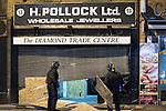 © Joel Goodman - 07973 332324 . 10/08/2011 . Manchester , UK . Police examine a looted jeweller on Withy Grove , as disorder spreads to Manchester during a 4th night of rioting and looting , following a protest against the police shooting of Mark Duggan in Tottenham . Photo credit : Joel Goodman