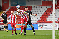 Ross Marshall of Stevenage F.C. heads clear during Stevenage vs Salford City, Sky Bet EFL League 2 Football at the Lamex Stadium on 3rd October 2020
