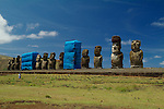 Moai undergoing preservation efforts in 2003 at Ahu Tongariki with Poike Volcano in the background. The second Moai from the right has a Pukao on its head. Ahu Tongariki is the largest Ahu on Rapa Nui/Easter Island. Ahu Tongariki was substantially restored in the 1990s by a multidisciplinary team headed by archaeologists Claudio Cristino and Patricia Vargas.