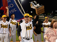 Jacksonville Suns manager Andy Barkett (17) hoists the championship trophy to the crowd after clinching the Southern League Championship Series against the Chattanooga Lookouts on September 12, 2014 at Bragan Field in Jacksonville, Florida.  Jacksonville defeated Chattanooga 6-1 to sweep three games to none.  (Mike Janes/Four Seam Images)