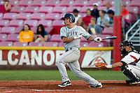 Ashley Graeter #9 of the Tri-City Dust Devils bats against the Salem-Keizer Volcanoes at Volcanoes Stadium on July 27, 2013 in Keizer, Oregon. Tri-City defeated Salem-Keizer, 5-4. (Larry Goren/Four Seam Images)