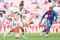 29th August 2021; Nou Camp, Barcelona, Spain; La Liga football league, FC Barcelona versus Getafe; Enes Unal of Getafe CF breaks away from Araujo of Barca