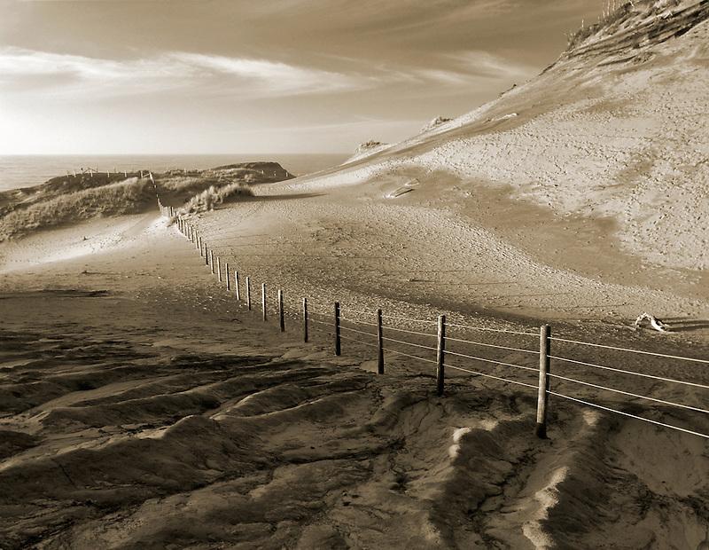 Fence line and ocean at Cape Kiwanda, Oregon