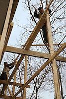 Azerbaijan. Oguz region. Oguz. Manual blue-collar workers build a wood scaffolding in front of a house.  © 2007 Didier Ruef