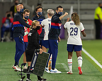 ORLANDO, FL - JANUARY 22: Head coach Vlatko Andonovski gives a fist bump to Catarina Macario #29 after she is substituted during a game between Colombia and USWNT at Exploria stadium on January 22, 2021 in Orlando, Florida.