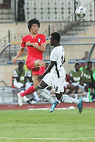 Ghana's Ransford Osei (18) beats South Korea's Suk Young Yun (17)  stands on the field before the match against South Korea during the FIFA Under 20 World Cup Quarter-final match between Ghana and South Korea at the Mubarak Stadium  in Suez, Egypt, on October 09, 2009.