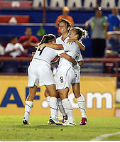 Yael Averbuch (4), Amy Rodriguez (8) and Megan Rapinoe (15) celebrate a goal at the 2010 CONCACAF Women's World Cup Qualifying tournament held at Estadio Quintana Roo in Cancun, Mexico.