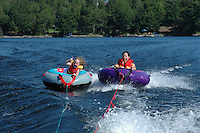 Tubing behind a speed boat