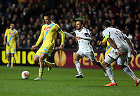 Swansea, UK. Thursday 20 February 2014<br /> Pictured L-R: Marek Hamsik of Napoli in control of the ball, followed by Leon Britton of Swansea<br /> Re: UEFA Europa League, Swansea City FC v SSC Napoli at the Liberty Stadium, south Wales, UK