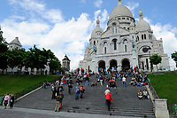Basilica of the Sacred Heart of Jesus of Paris, capital of France. The Basilique Sacré-Coeur is a Roman Catholic church and familiar landmark in Paris, located on the highest point of the city in Montmartre. After France's 1870 defeat by the Prussians in the Franco-Prussian War and its aftermath, the Commune of 1871, the basilica was planned as a guilt offering and a vote of confidence to cure France's misfortunes. The foundation stone of the Basilique Sacré-Coeur was laid in 1875. It was consecrated in 1891, fully completed in 1914, and elevated to the status of a basilica in 1919, after the end of the First World War.
