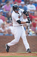 Winston-Salem shortstop Robert Valido makes contact with the ball versus Kinston at Ernie Shore Field in Winston-Salem, NC, Tuesday, July 4, 2006.  The Warthogs defeated the Indians 3-2.
