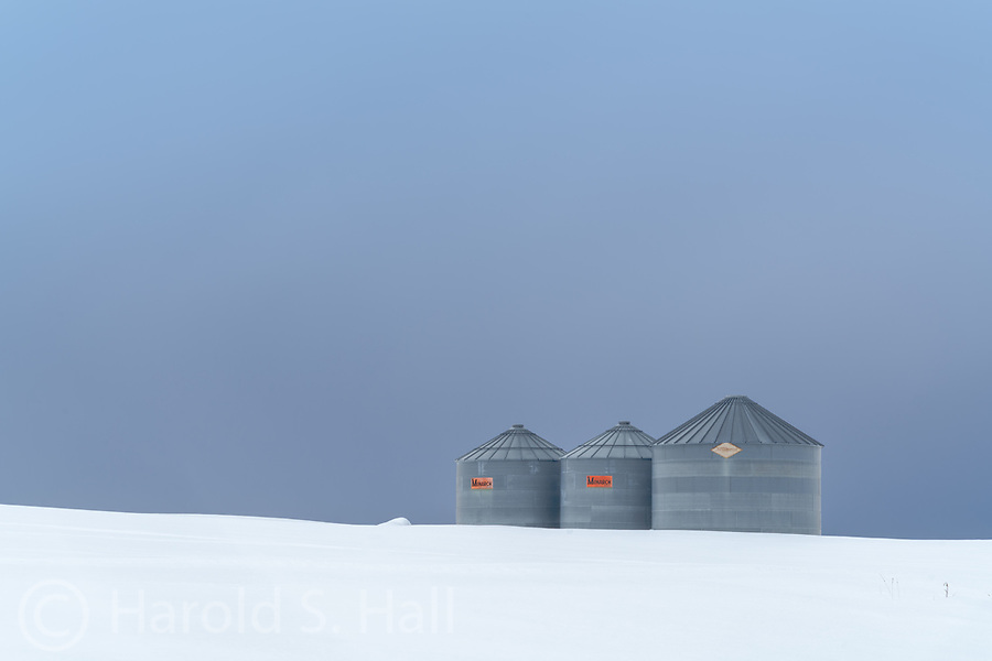 The steel gray grain containers seemed to match the steel gray skies.
