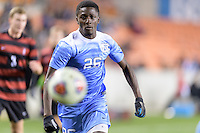 Houston, TX - Friday December 9, 2016: Jelani Pieters (26) of the North Carolina Tar Heels chases after a loose ball against the Stanford Cardinal  at the NCAA Men's Soccer Semifinals at BBVA Compass Stadium in Houston Texas.