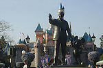 STATUE OF WALT DISNEY AND MICKEY MOUSE IN FRONT OF SLEEPING BEAUTY CASTLE