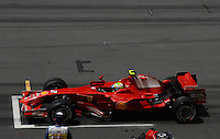 Felipe Massa from Brazil the Ferrari team in his Ferrari SECONDS BEFORE THE START FORMULA 1 WINNER IN SEPANG MALAYSIA WAS KIMMI RAIKKONEN from Finland IN HIS FERRARI FIRST PLACE, SECOND PLACE WENT TO ROBERT KUBICA from Poland IN HIS BMW-SAUBER, THIRD PLACE WENT TO HEIKKI KOVALAINEN from Finland IN A MCLAREN.