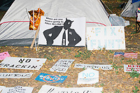People make protest signs near the free-food distribution area in FDR Park outside of the secure area surrounding the Democratic National Convention at the Wells Fargo Center in Philadelphia, Pennsylvania, on Wed., July 27, 2016.