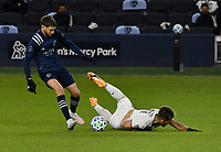 KANSAS CITY, KS - OCTOBER 24: #6 Ilie Sanchez of Sporting Kansas City fouls #11 Diego Rubio of the Colorado Rapids in midfield during a game between Colorado Rapids and Sporting Kansas City at Children's Mercy Park on October 24, 2020 in Kansas City, Kansas.