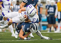 8 October 2016: Amherst College Purple & White Wide Running Back Nick Kelly, a Senior from Westport, CT, is taken down by Middlebury College Panther Defensive Back Matthew Daniel, a Sophomore from Wellesley, MA, at Alumni Stadium in Middlebury, Vermont. The Panthers edged out the Purple & While 27-26. Mandatory Credit: Ed Wolfstein Photo *** RAW (NEF) Image File Available ***