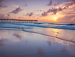 Cape Hatteras National Seashore, Avon, North Carolina<br /> Sunrise and beach reflections with Avon fishing pier in the distance