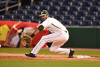 USF Bulls first baseman Buddy Putnam (5) stretches for a throw during a game against the Louisville Cardinals on February 14, 2015 at Bright House Field in Clearwater, Florida.  Louisville defeated USF 7-3.  (Mike Janes/Four Seam Images)
