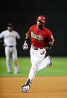May 19, 2010; Phoenix, AZ, USA; Arizona Diamondbacks outfielder Justin Upton rounds the bases after hitting a solo home run in the fourth inning against the San Francisco Giants at Chase Field. Mandatory Credit: Mark J. Rebilas-