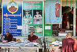 18 JUNE 2015, Mandalay, Myanmar:  Photographs of 969 activist Monk Wirathu hang over monks during some relaxation time  outside his quarters in the Masoeyein Monastery in Mandalay, Myanmar. Picture Graham Crouch/The Australian Magazine