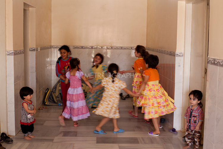 QAIM, IRAQ: Syrian children play in a disused building at the Qaim refugee camp in Iraq...Over 4,450 Syrian refugees have fled the violence in Syria and are living in the Qaim refugee camp in Iraq...Photo by Ali Arkady/Metrography