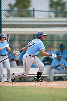 Tampa Bay Rays third baseman Luis Leon (97) follows through on a swing during an Instructional League game against the Pittsburgh Pirates on October 3, 2017 at Pirate City in Bradenton, Florida.  (Mike Janes/Four Seam Images)