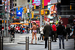 The Naked Cowboy stands in Times Square displaying a Welcome Bank NYC message on monitors in New York on Wednesday, April 14, 2021. Photographer: Michael Nagle