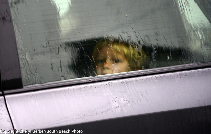 A child looks out that window while stranded in flooded French Quarter street. Heavy rains flooded streets and businesses ahead of Tropical Depression Barry, which is expected to make landfall as a Category 1 hurricane on Sat., in New Orleans, Wed., July, 10, 2019.