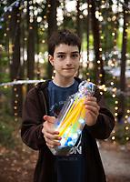 Boy Holding Lit Art Display, Arts A Glow Festival 2017, Dottie Harper Park, Burien, WA, USA.