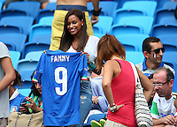 Fanny Neguesha, the fiancee of Mario Balotelli of Italy, shows off an Italy shirt with Balotelli's number and her name on