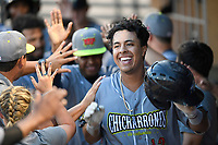 Designated hitter Mark Vientos (13) of the Columbia Fireflies, playing as the Chicharrones de Columbia, is swamped by teammates after hitting the first inside-the-park home run in the stadium's history in a game against the Charleston RiverDogs on Friday, July 12, 2019 at Segra Park in Columbia, South Carolina. The RiverDogs won, 4-3 in 10 innings. (Tom Priddy/Four Seam Images)
