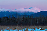 Pondicherry Wildlife Refuge - Scenic view of the Presidential Range covered in snow  from along the Presidential Range Rail Trail (a segment of the Cohos Trail), near Cherry Pond, in Jefferson, New Hampshire just after sunset.