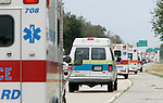 Five ambulances run with lights and sirenes north on the shoulder of Interstate 10 north of New Orleans, Louisiana  because the interstate if filled with cars trying to evacuate the city ahead of Hurricane Katrina Sunday August 28, 2005.  The tropical cyclone, which killed seven at first landfall in south Florida as a category one is taking aim on New Orleans as a category 5 killer.