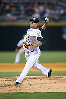 Charlotte Knights relief pitcher Arcenio Leon (36) in action against the Norfolk Tides at BB&T BallPark on April 9, 2015 in Charlotte, North Carolina.  The Knights defeated the Tides 6-3.   (Brian Westerholt/Four Seam Images)