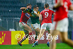 Gavin White, Kerry in action against Killian O' Hanlon, Cork, and Ian MaGuire, Cork, during the Munster GAA Football Senior Championship Semi-Final match between Cork and Kerry at Páirc Uí Chaoimh in Cork.