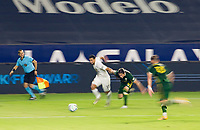 CARSON, CA - OCTOBER 07: Sebastian Lletget #17 of Los Angeles Galaxy and Jorge Villafana #4 of the Portland Timbers move to the ball during a game between Portland Timbers and Los Angeles Galaxy at Dignity Heath Sports Park on October 07, 2020 in Carson, California.