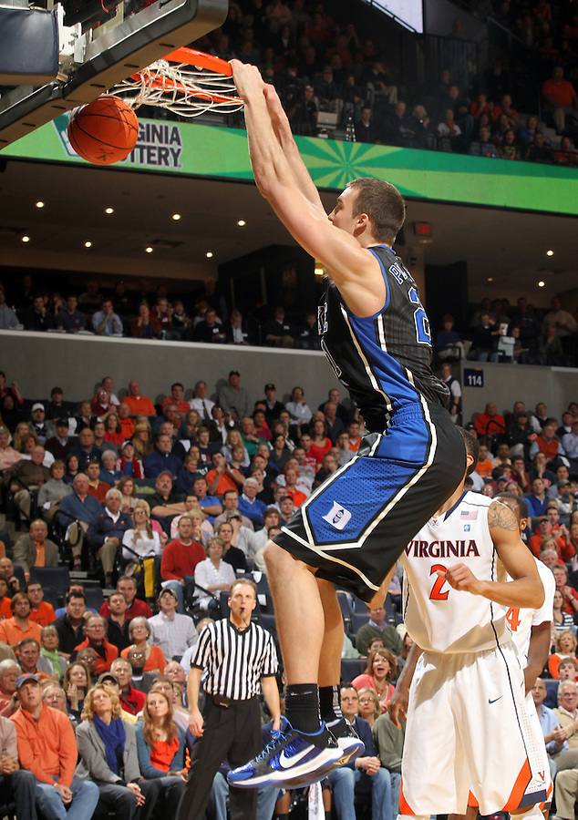 Feb. 16, 2011; Charlottesville, VA, USA; Duke Blue Devils forward Miles Plumlee (21) dunks the ball in front of Virginia Cavaliers guard Mustapha Farrakhan (2) during the second half of the game at the John Paul Jones Arena. The Duke Blue Devils won 56-41.  Credit Image: © Andrew Shurtleff
