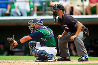 Charlotte Knights catcher Miguel Gonzalez (27) sets a target as home plate umpire Gabe Morales looks over his shoulder during the International League game against the Durham Bulls at Knights Stadium on August 18, 2013 in Fort Mill, South Carolina.  The Bulls defeated the Knights 8-5 in Game One of a double-header.  (Brian Westerholt/Four Seam Images)
