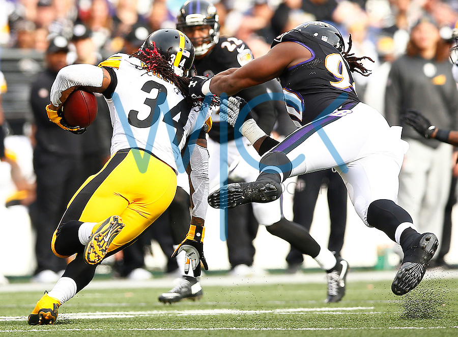 DeAngelo Williams #34 of the Pittsburgh Steelers is tackled by his hair in the second quarter by Za'Darius Smith #90 of the Baltimore Ravens during the game at M&T Bank Stadium on December 27, 2015 in Baltimore, Maryland. (Photo by Jared Wickerham/DKPittsburghSports)