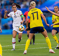 LE HAVRE,  - JUNE 20: Alex Morgan #13 shoots during a game between Sweden and USWNT at Stade Oceane on June 20, 2019 in Le Havre, France.