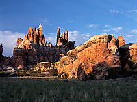 This large sandstone buttress emphasizes the delicacy of the needles and hoodoos behind it