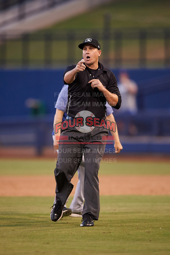 AZL Rangers manager Carlos Cardoza (65) is ejected by umpire Larry Dillman Jr. during an Arizona League game against the AZL Brewers Blue on July 11, 2019 at American Family Fields of Phoenix in Phoenix, Arizona. The AZL Rangers defeated the AZL Brewers Blue 5-2. (Zachary Lucy/Four Seam Images)